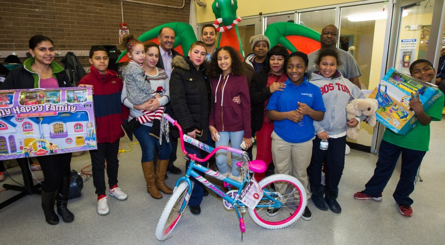 Cruz Companies Hosts Holiday Gift Giving Celebration for Young Residents in Roxbury